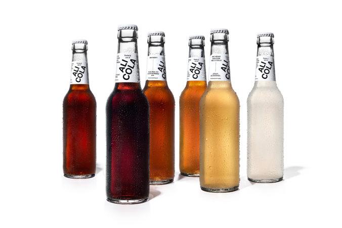 Geschäftsidee für mehr Toleranz - Cola in verschiedenen Farben, aber gleichem Inhalt. Wie Menschen eben.